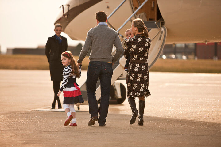 Family walking out to private jet