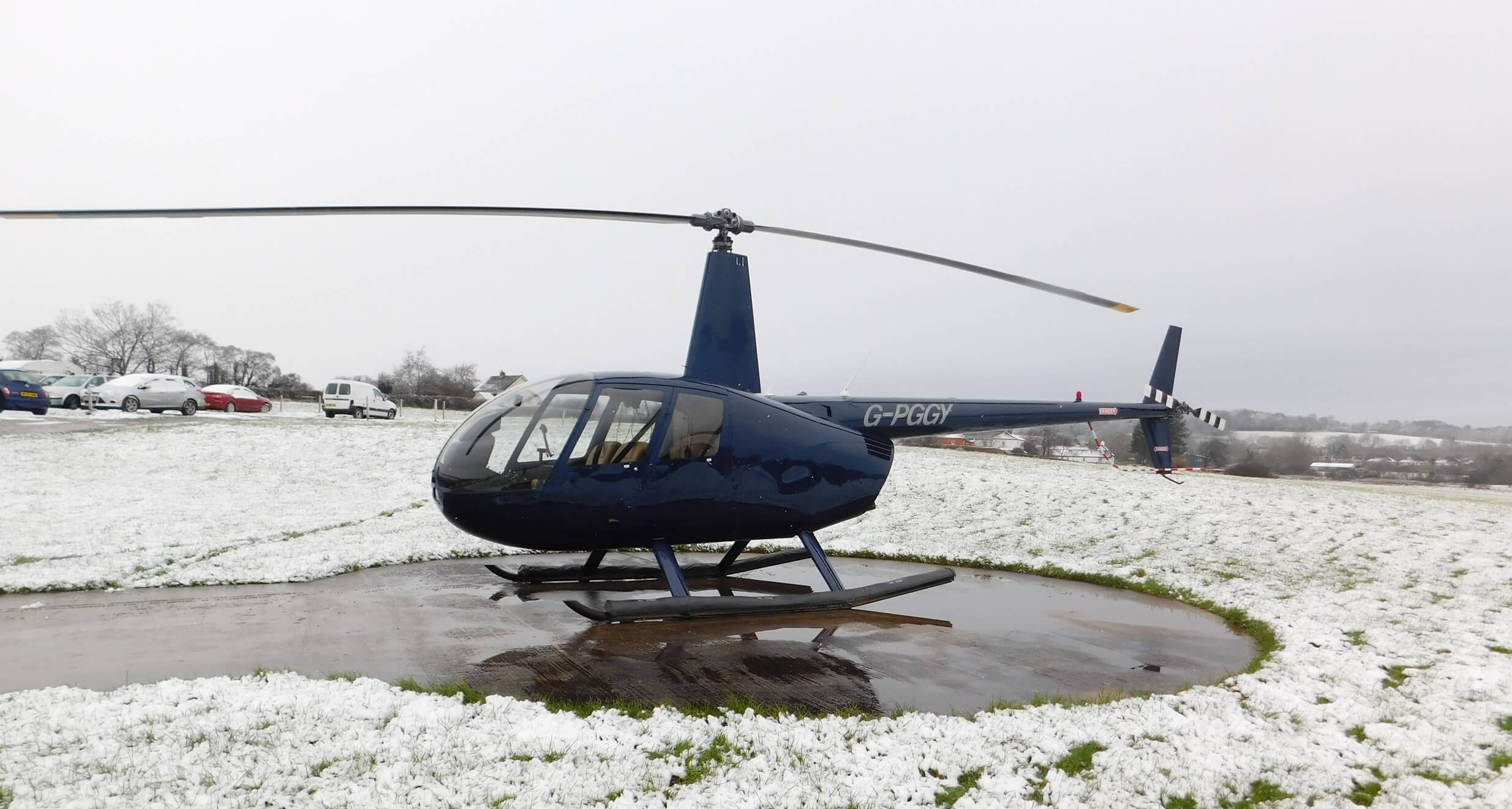 Robinson R44 on the pad ready to charter